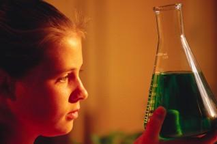Chemistry Student Studying Green Liquid